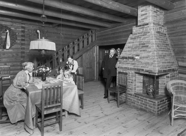 The Sibelius family in 1915 in the dining hall, the green tile fireplace on the left, Aino and Jean Sibelius' Ainola
