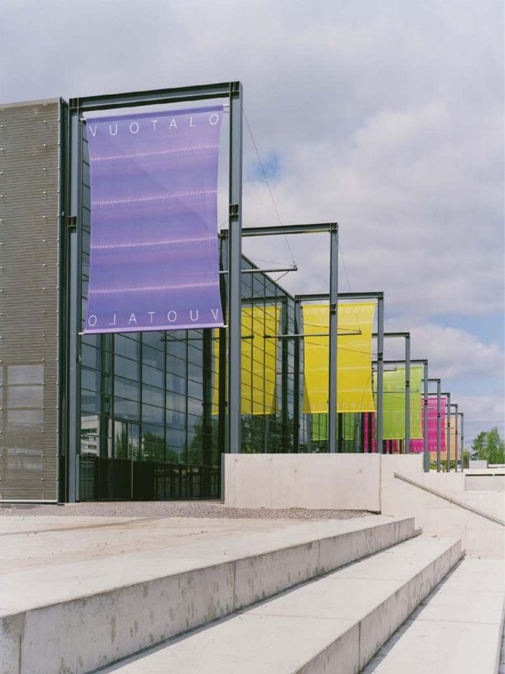 Steel structure and the flags highlight the pedestrian route, Vuotalo Cultural Centre